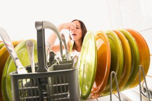 Women Holding Her Nose by Her Smelly Dishwasher